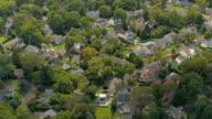 AERIAL: Luxury suburban houses in quiet modern neighborhood on sunny autumn day video
