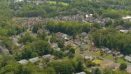 AERIAL: Luxury suburban houses in quiet modern neighborhood on sunny summer day video