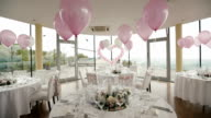 Luxury wedding hall decorated with pink balloons and flowers video