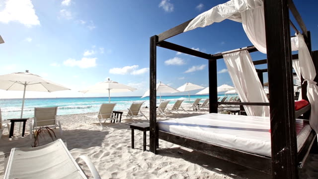 Luxury wooden lounge bed on beach video