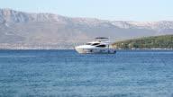 luxury yacht anchoring in mediterranean bay video