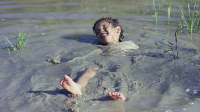 Lying in the Muddy Water video