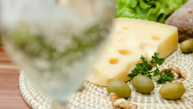 Maasdam cheese with white wine, olives and nuts video