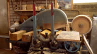 Machine is sanding a wooden block into a clog shaped object video