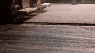 Machine making layer of asphalt. video