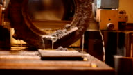 Machine with a wide metal band saw using an oil-based lubricant, and emulsions. Very Slow sawing thick piece of cast metal video