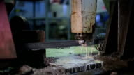 Machine with metal band saw. slow sawing thick piece of pure metal using an oil-based lubricant, and emulsions video