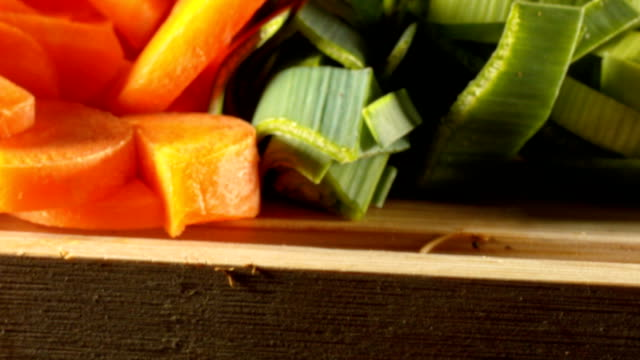 Macro dolly: Silde over vegetables cut into peaces for soup video