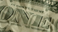 Macro elements on the US one dollar bill. US dollars background video