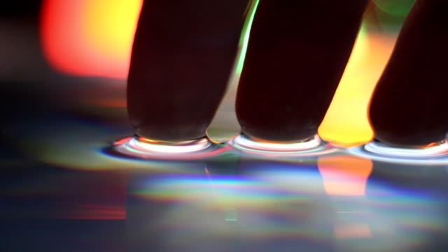 Macro finger tips touching water video