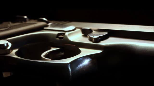 Macro flyover of 9mm pistol video