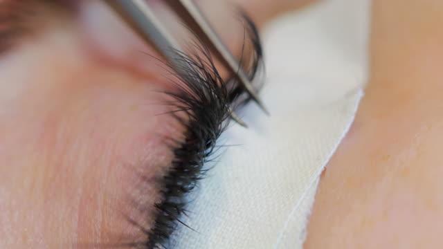 Macro of extension eyelash application video