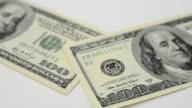 Macro shot of a one hundred dollar bill. video