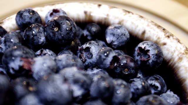 macro shot of blueberries rotating on the breakfast table. video