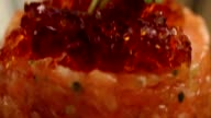 Macro shot of fancy dish. Raw salmon with jelly on top. video