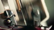 Macro shot of running sewing machine video