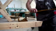 macro shot of wooden ruler in carpenter workshop video