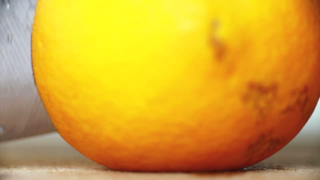 Macro slicing an orange video