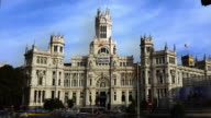 madrid city hall cibeles palace with welcome refugees flag in the front timelapse video