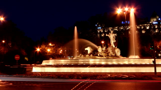 Madrid NE`tune statue and Calle de Alcalá night Time lapse video