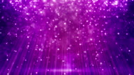 magenta loopable background flying particles in light beams video