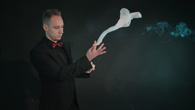 Magician showing a magic trick video