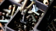 Magnet attracts iron bolts of various hardware fasteners, nuts, bolts, screws, in box video