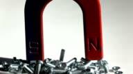 U Magnet Pulling Metal Scrwes In Slow Motiın video