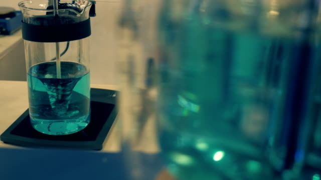 Magnetic stirrer and classic stirrer of liquid is prepared solution video