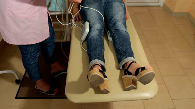 Magnetic therapy for girl patient in modern clinic video