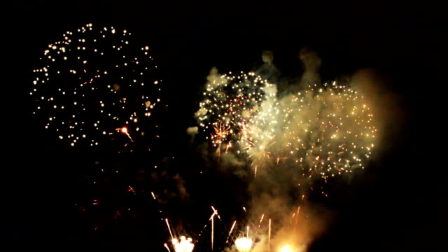 Magnificent yellow and gold sparkling firework display video
