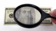 Magnifying hundred dollar bill - HD video