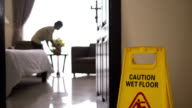 Maid at work and cleaning in luxury hotel room video