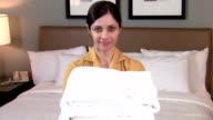 Maid portrait holding towels - HD video