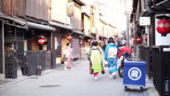 KYOTO, JAPAN - March 2015: Maiko, young training geisha walks on the streets of Gion area in Kansia video