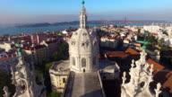 main facade of the Estrela Basilica in Lisbon at morning aerial view video