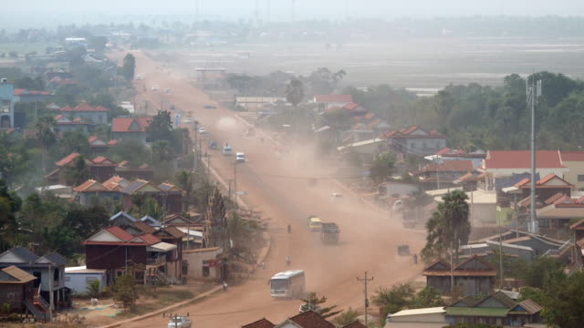 main village dusty road going through small town video