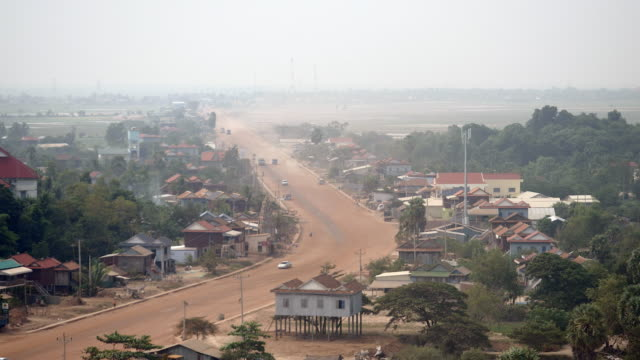 Main village dusty road going through small town (time lapse) video