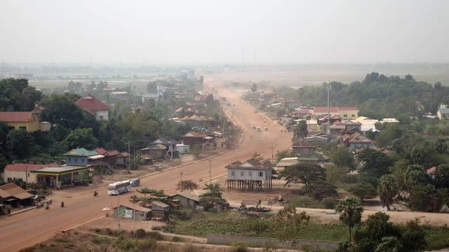 Main village dusty road going through small town ( time lapse) video