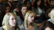 Mainly Young women at university lecture video