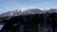 AERIAL: Majestic snow-capped mountain video