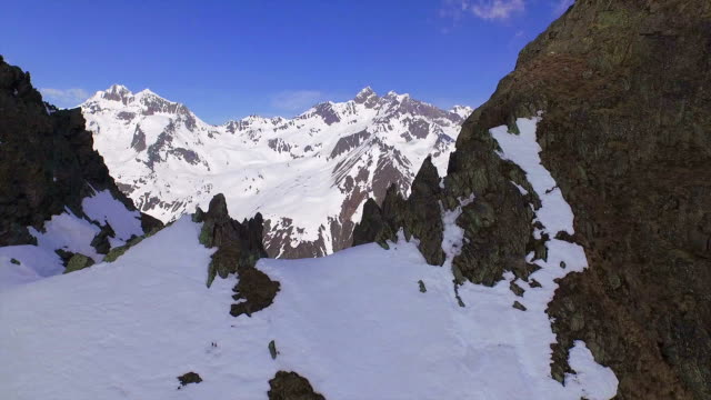 AERIAL: Majestic snowy mountains in sunny winter video