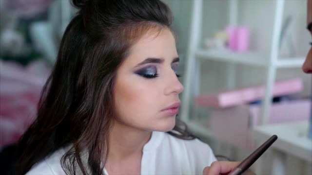 Make up artist apply blush on the cheekbones model video