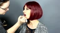 Make Up Artist Putting on Lipstick on Model video