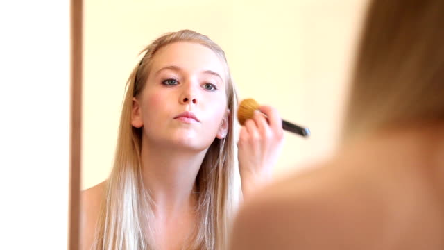 Make Up Video Series: Woman Applying Blusher to face video
