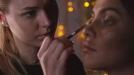 Makeup Artist Applying Eye Shadows with Brush video