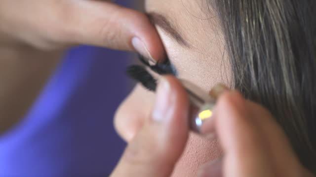 Makeup Artist Applying Make-up on Woman Eye video