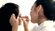 Make-up artist applying makeup video