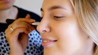 makeup artist gets tone on the skinof the model video