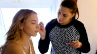makeup artist paints the eyes of the model video